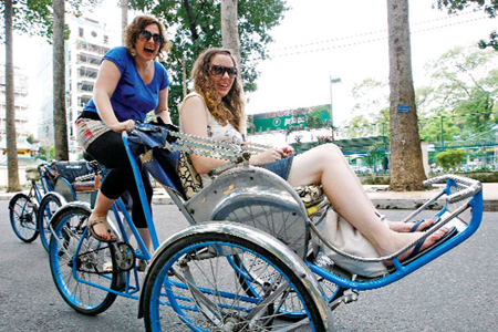 Cyclo (xich lo) is one of the best way to discover Hanoi