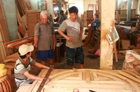 An artisan teaching his students, Bich Chu Carpentry Village