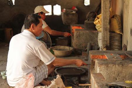 Artisans forging metal tools