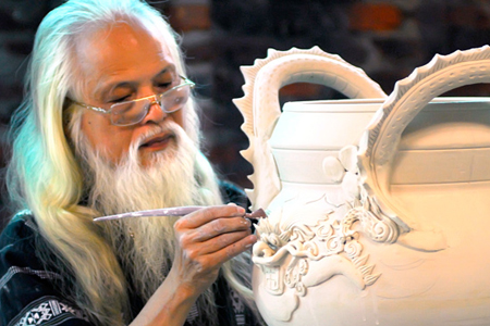 Skillful artisan decorating ceramic product, Bat Trang Village