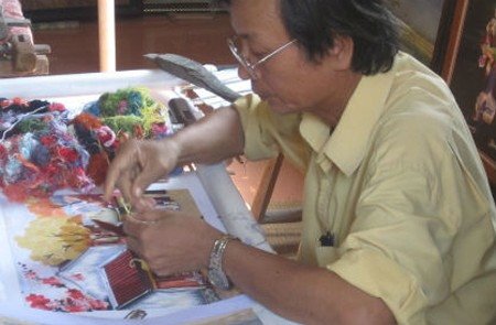 Skillful hands of artisan on embroidery products