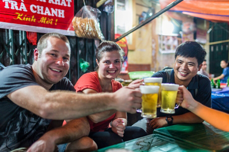 Sip on cooling Bia Hoi in restaurant