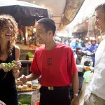Tourists with guide in local market with Highway 4 Cooking Class