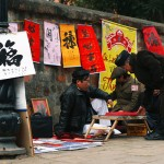 Calligrapher outside of Temple of Literature, Hanoi in Tet Holiday