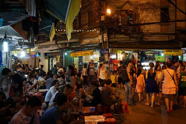 Bustling atmosphere in the streets near Hanoi Night Market