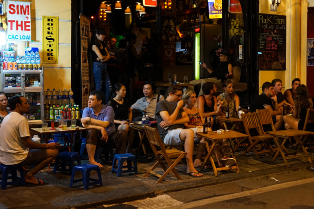 Foreigners enjoy coffee and see the nightlife in Hang Buom Street
