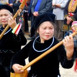 Tay women playing traditional intrument