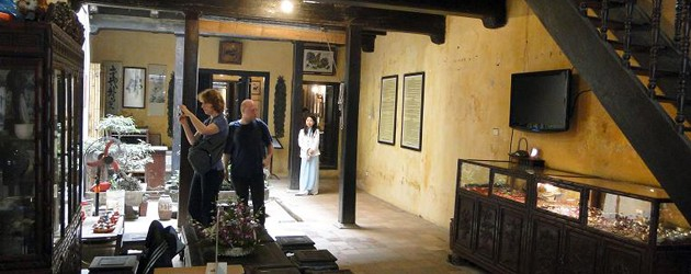 Tourist walk around and take photo of 87 Ancient House
