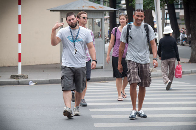 Foreigners crossing the street in Hanoi