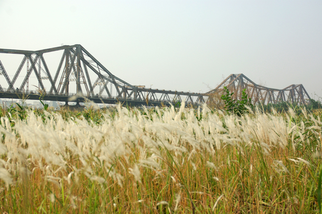 View of Long Bien bridge from the bank of Red River